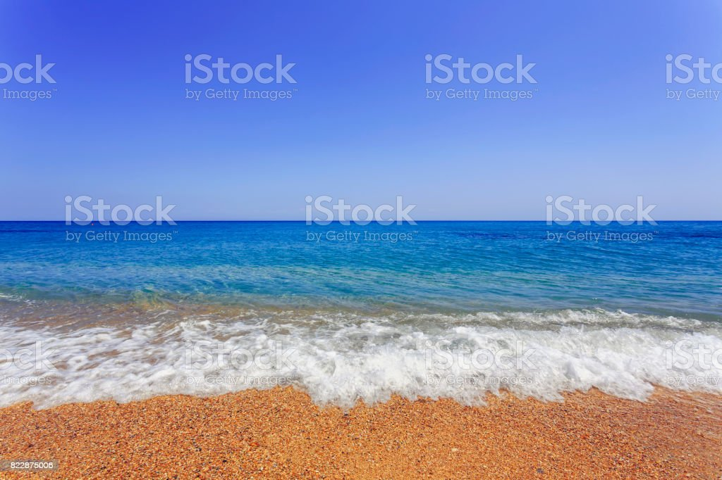 Blue clear sky above the Ionian Sea at Skala beach in Kefalonia stock photo