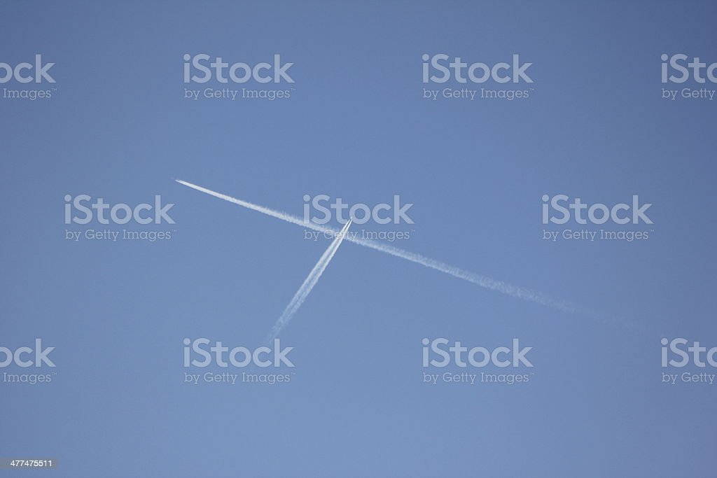 Blue Clear Sky & White Condensation Trail of two Aircrafts royalty-free stock photo