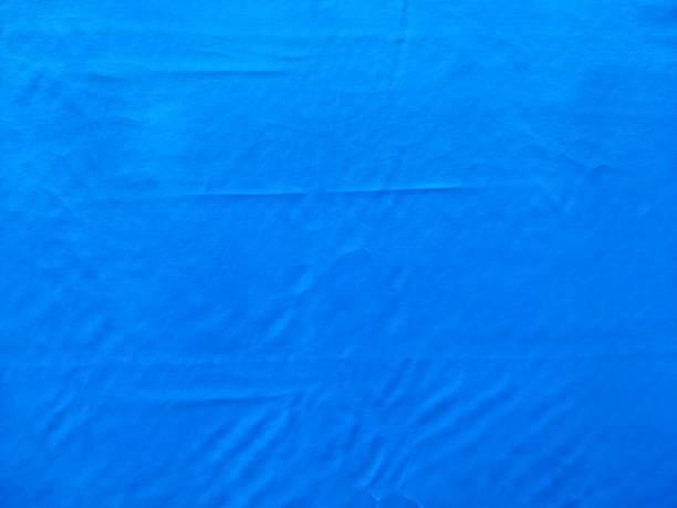blaues tuch markise textur hintergrund - planenzelt stock-fotos und bilder