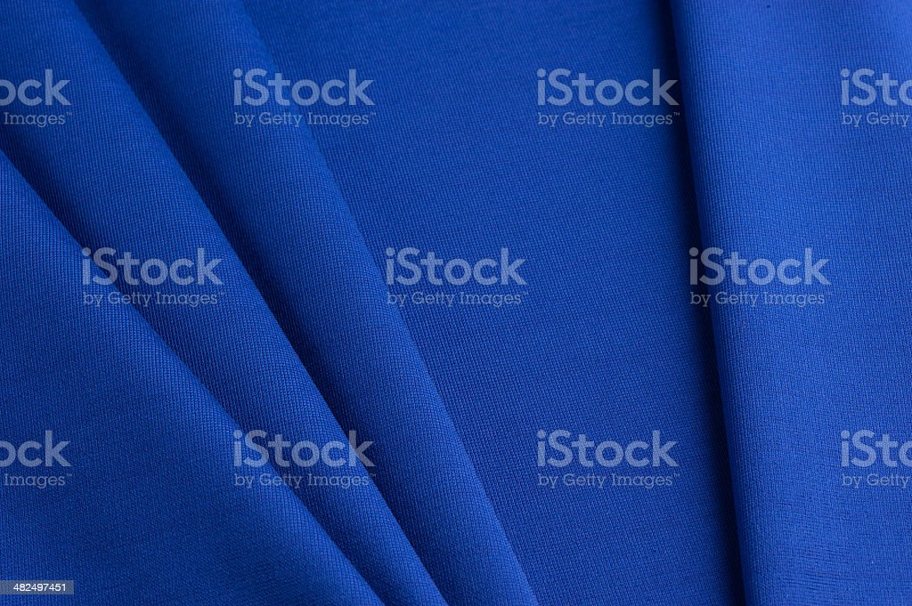 Blue cloth with straight folds stock photo
