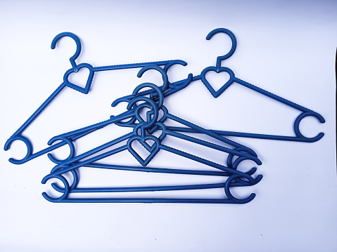 Blue clothes hanger isolated on a white background