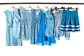 Blue clothes on clothes racks