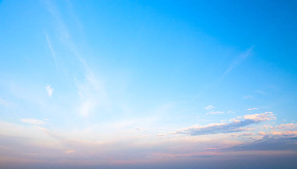 Blue cloudy sky at evening. Natural background stock photo