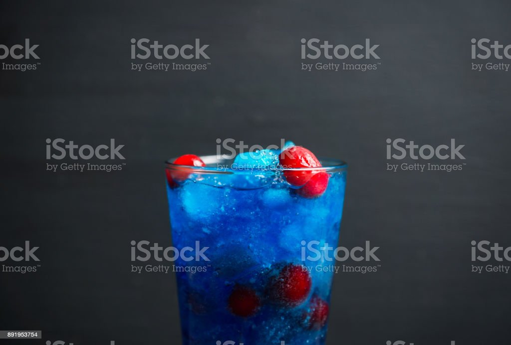 Blue cocktail with cranberry on the wooden background stock photo