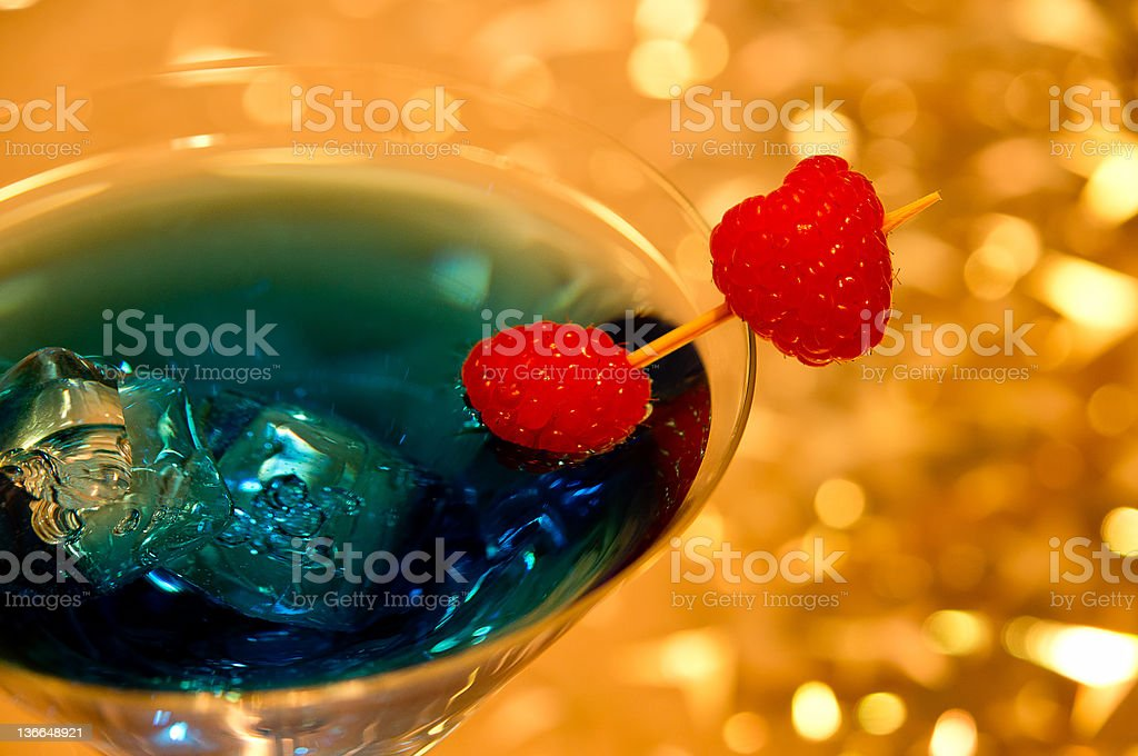 blue cocktail with raspberry royalty-free stock photo