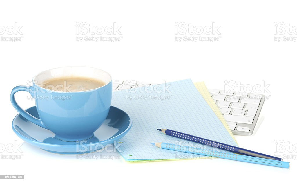 Blue coffee cup and office supplies royalty-free stock photo