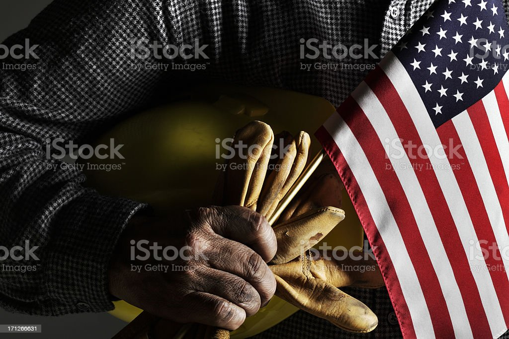 Blue Collar Worker Holding Work Gloves and American Flag royalty-free stock photo