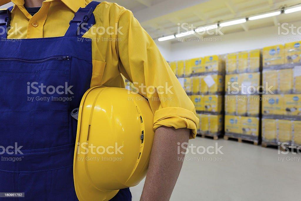 Blue collar worker Closeup of a blue collar worker holding hard hat Artist's Palette Stock Photo