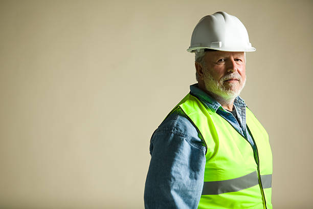 blue collar worker portraits stock photo