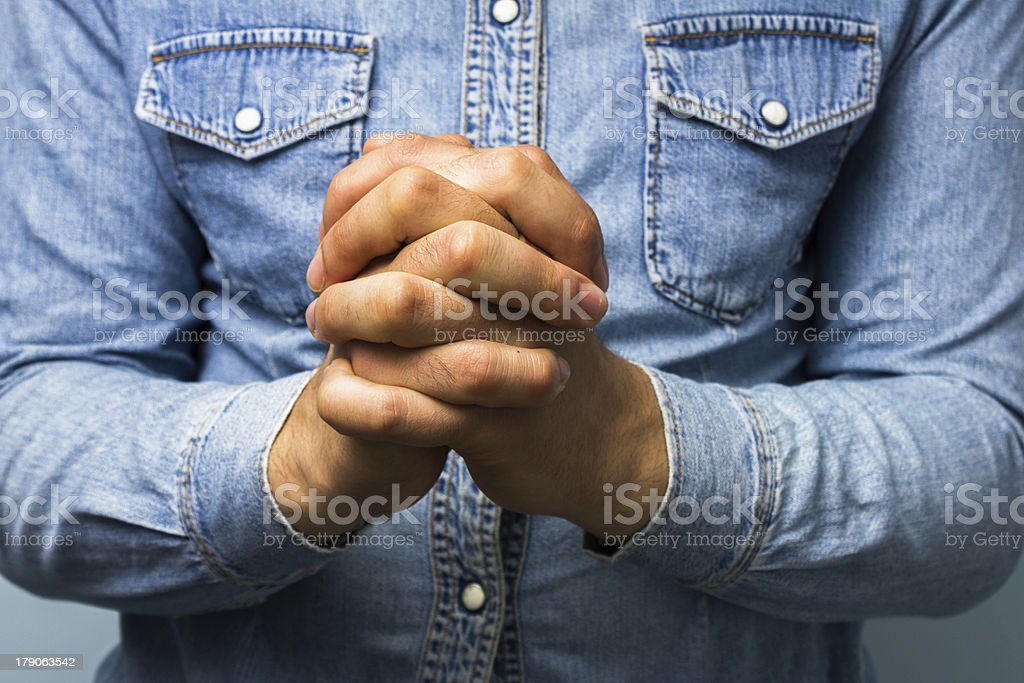 Blue collar worker with hands folded royalty-free stock photo