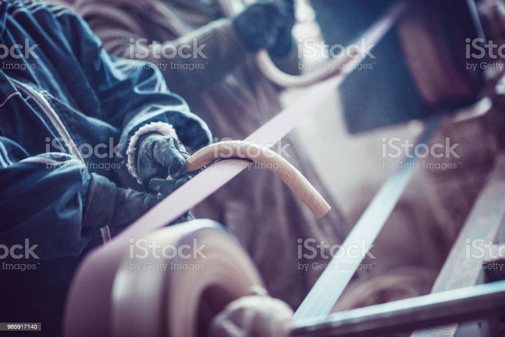 Blue Collar Workers Finishing Morning Work By Polishing Wooden Handles - Royalty-free Art And Craft Stock Photo