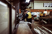Manual workers and qualified workforce working in metal processing and electric industry