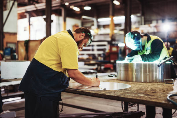 Blue collar workers in industry - welding and metal cutting