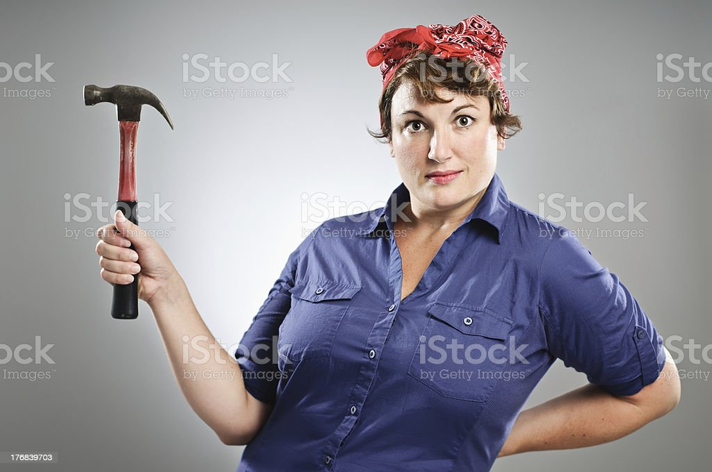 Blue Collar Working Girl With A Hammer stock photo