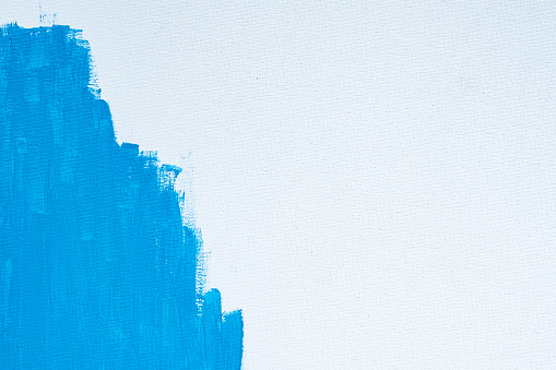 1084390994 istock photo Blue color abstract paint with a brush and textures of water color oil colour drawing lines on white canvas background 1250922205