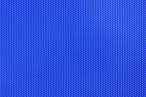 Blue honeycomb pattern background of many tiny hexagonal geometrical shapes in soft plastic.