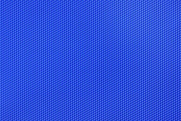 blaue farbe hintergrund bienenwaben-muster - polypropylen stock-fotos und bilder