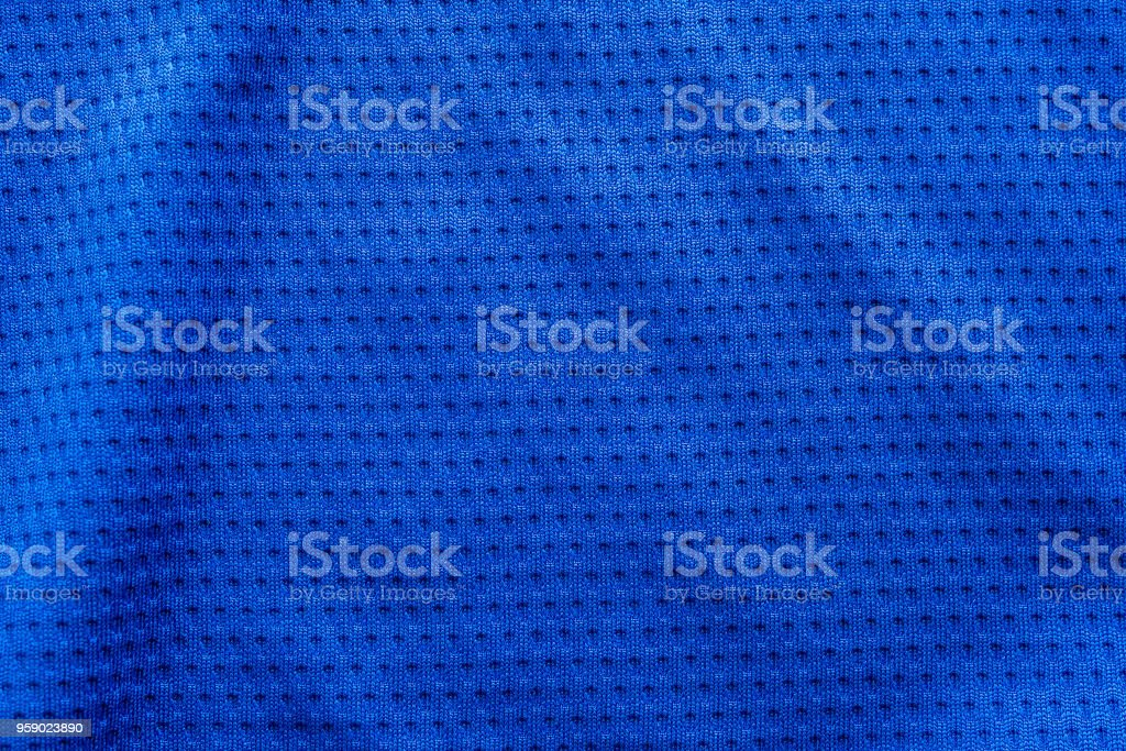 Blue color fabric sport clothing football jersey with air mesh texture background stock photo