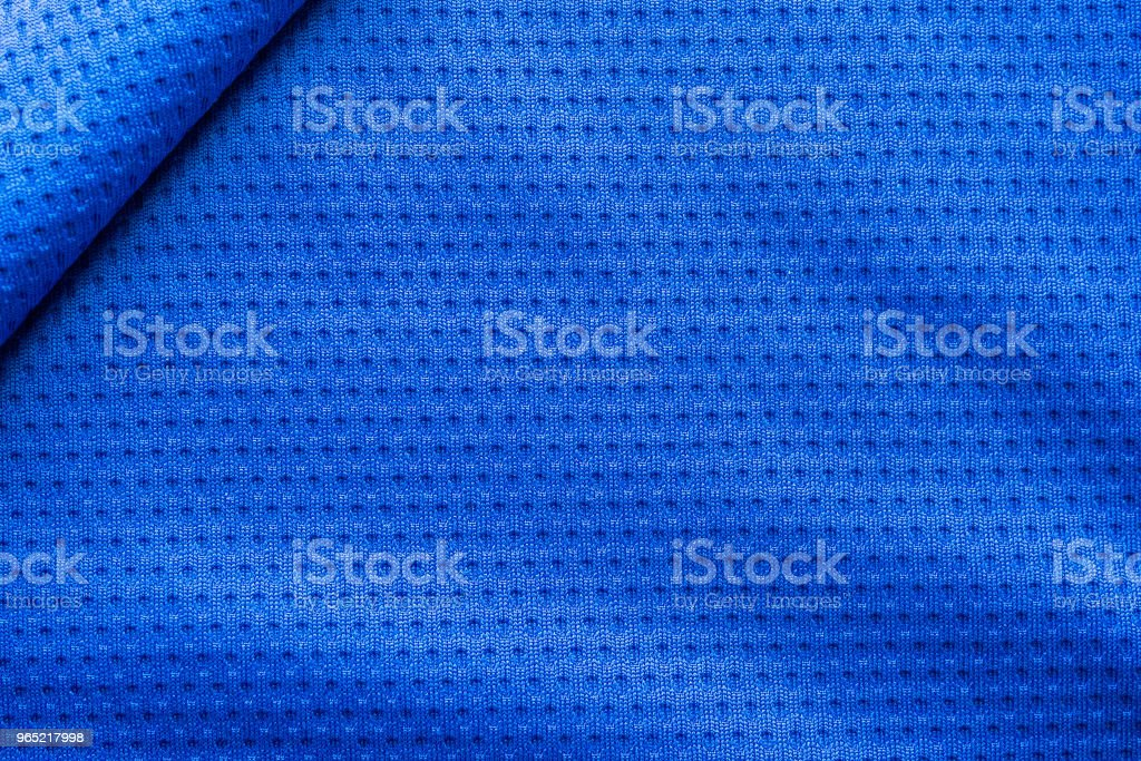 Blue color fabric sport clothing football jersey with air mesh texture background royalty-free stock photo