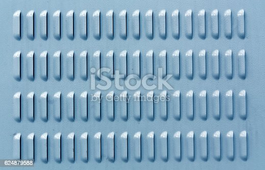 istock Blue color metal surface with ventilation holes. 624879588