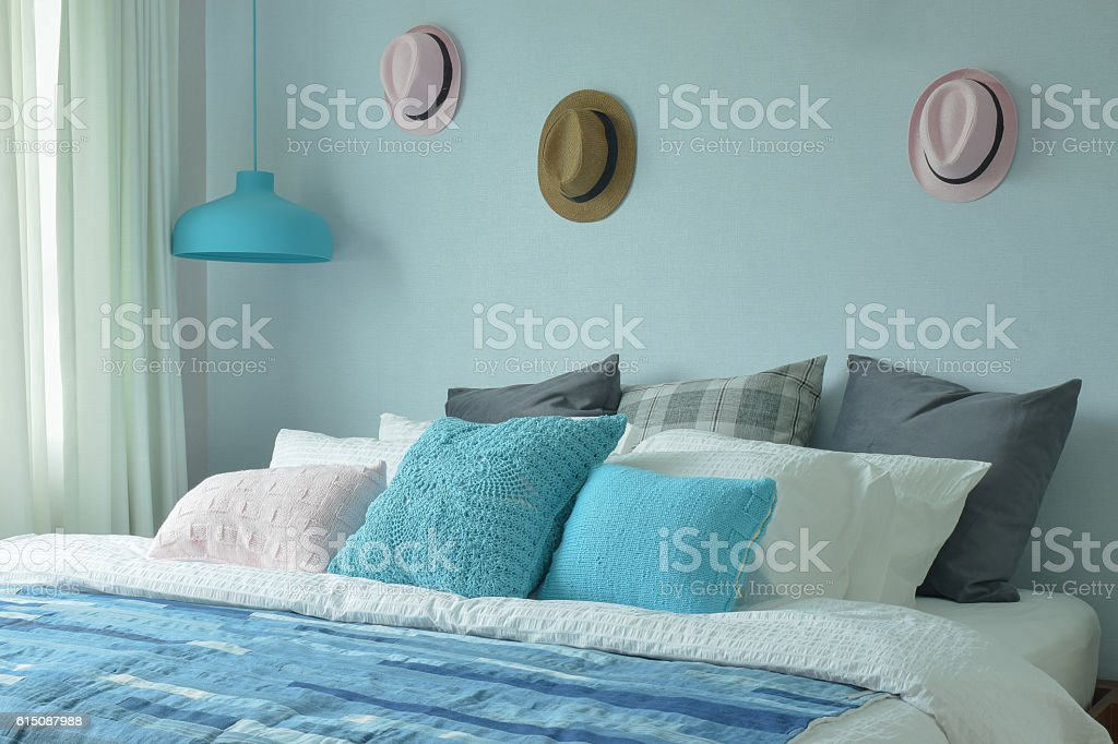 Blue color scheme teenager bedroom with hats on wall decoration stock photo