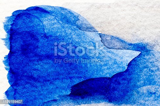 847999586 istock photo Blue color watercolor handdrawing as brush or banner on white paper background 1129159407