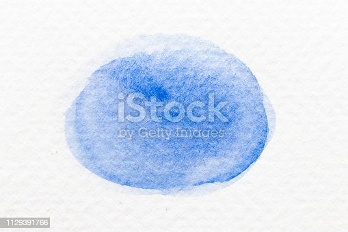 847999586 istock photo Blue color watercolor handdrawing as brush or banner on white paper background 1129391766