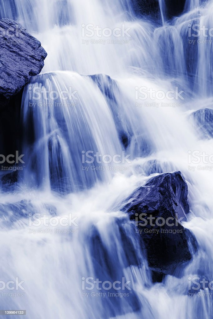 Blue colored blurred style waterfall royalty-free stock photo