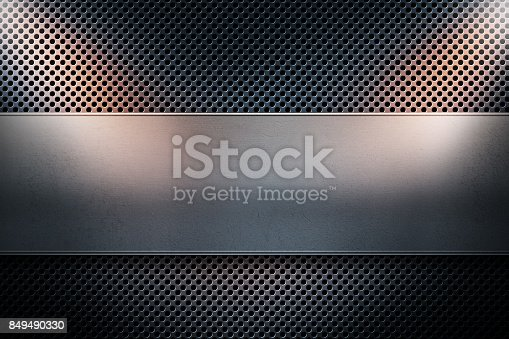 istock Blue colored perforated metal plate with metal banner and two yellow spotlights on the sides 849490330