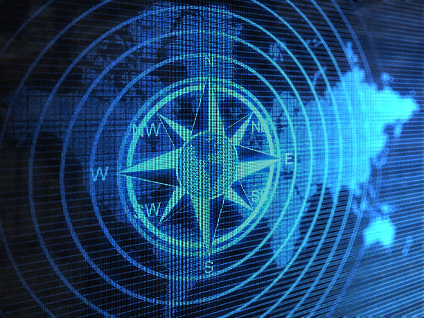 Blue compass with circles over blue world map stock photo
