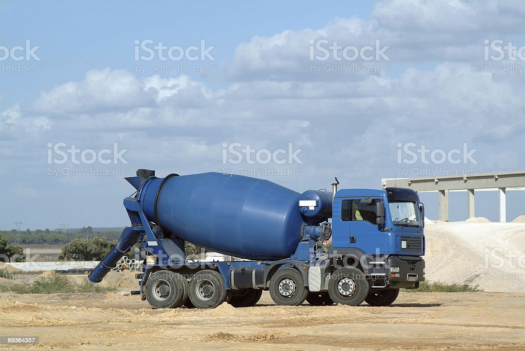 Blue concrete truck mixer in the workmanship royalty-free stock photo