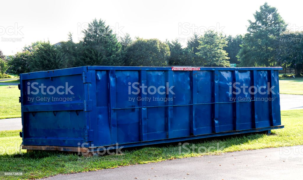 Blue Construction Dumpster stock photo