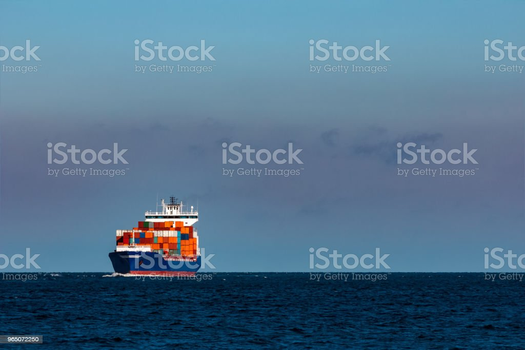 Blue container ship in Baltic sea royalty-free stock photo