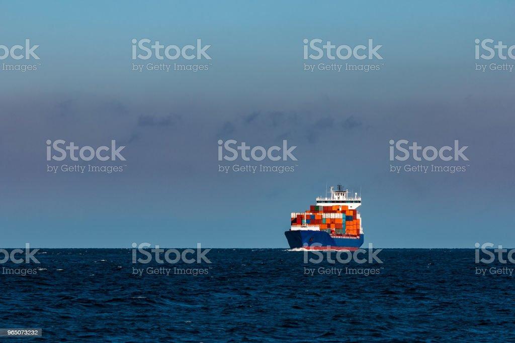 Blue container ship in Baltic sea zbiór zdjęć royalty-free