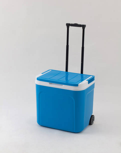 Blue cooling box with adjustable handle and wheels isolated stock photo