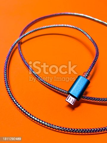 istock blue cord on contrasting orange background in vertical layout 1311292489