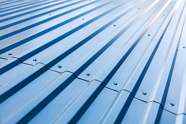 blue corrugated metal roof with rivets blue corrugated metal roof with rivets, industrial background metal stock pictures, royalty-free photos & images