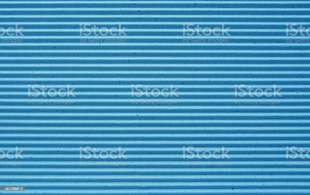 blue corrugated paper background. stock photo