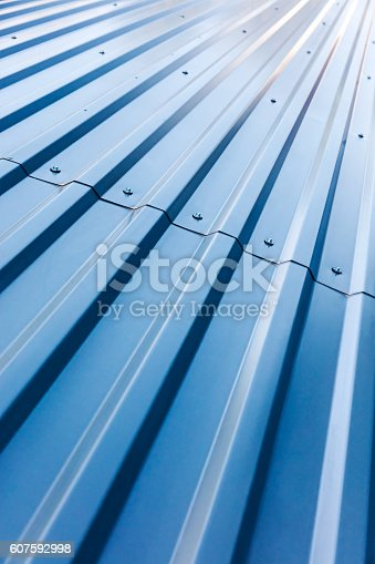 istock blue corrugated steel roof with rivets 607592998