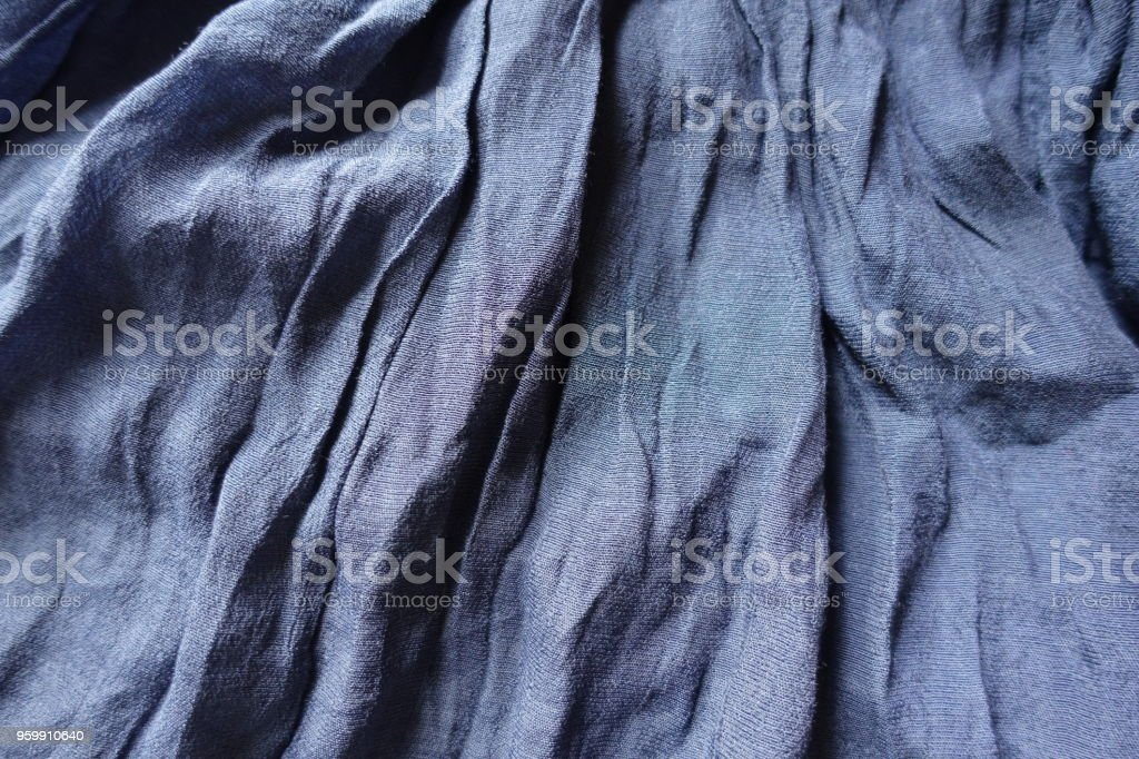 Blue cotton and polyester fabric in soft folds stock photo