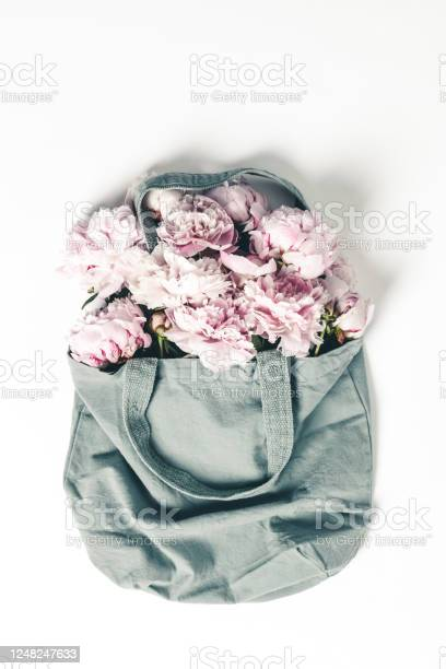 Blue cotton eco tote bag with peony flowers on white background flat picture id1248247633?b=1&k=6&m=1248247633&s=612x612&h=vwrw4h5imlidaogylzr5ijerdio7tt st1a x9t ytg=