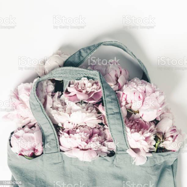 Blue cotton eco tote bag with peony flowers on white background with picture id1248247626?b=1&k=6&m=1248247626&s=612x612&h=o5ivywle4q94akze0t3y h6bdhs8j5asv0ayf8 z4ak=