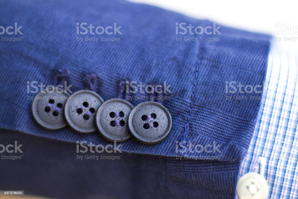 Blue Cotton Men's Sports Jacket Sleeve Cuff, 4 Buttons (Close-Up) stock photo