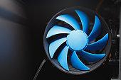 blue cpu cooler inside PC case, close-up view