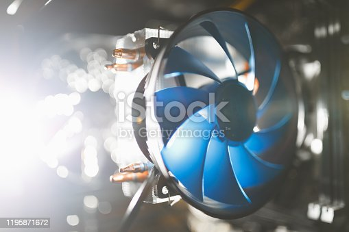 istock blue cpu cooler inside PC case, shiny light background 1195871672