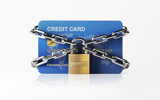 A blue credit card  chained with padlock. There is security stamp on padlock. Horizontal composition with copy space. Front view. Great use for e-commerce, online shopping and security related cocepts. Clipping path is included. Isolated on white background.