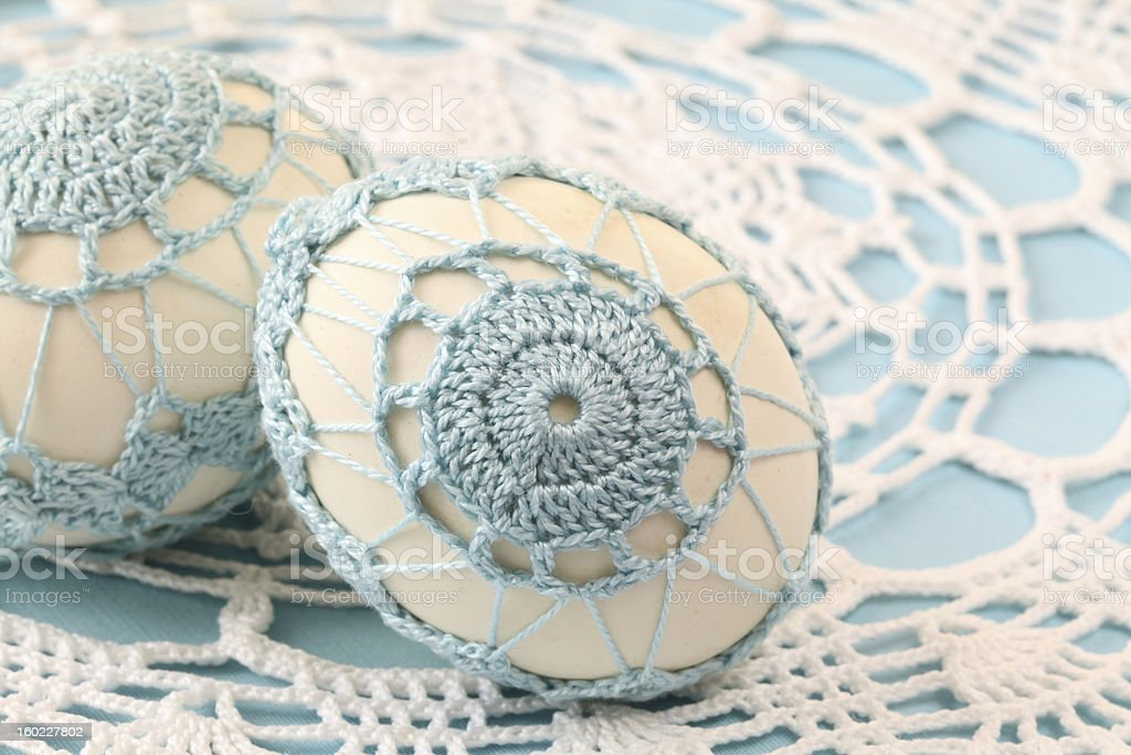 Blue crochet Easter eggs stock photo