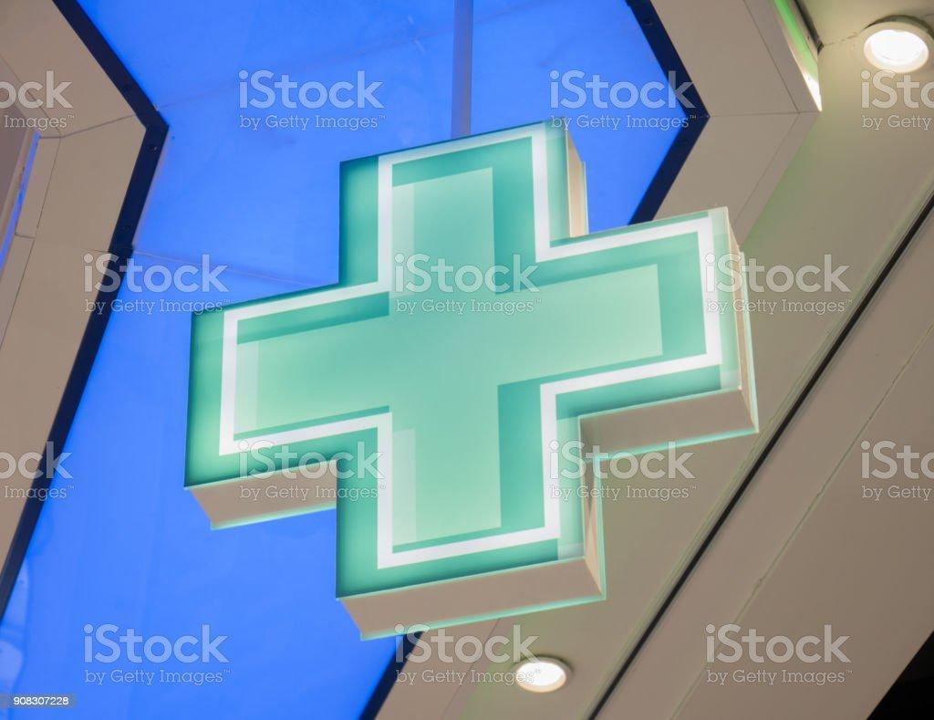 Blue cross sign stock photo