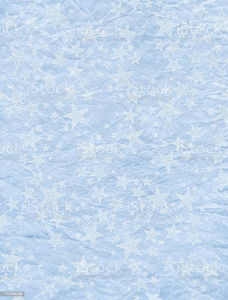 blue crumpled wrapping paper with grungy stars royalty-free stock photo