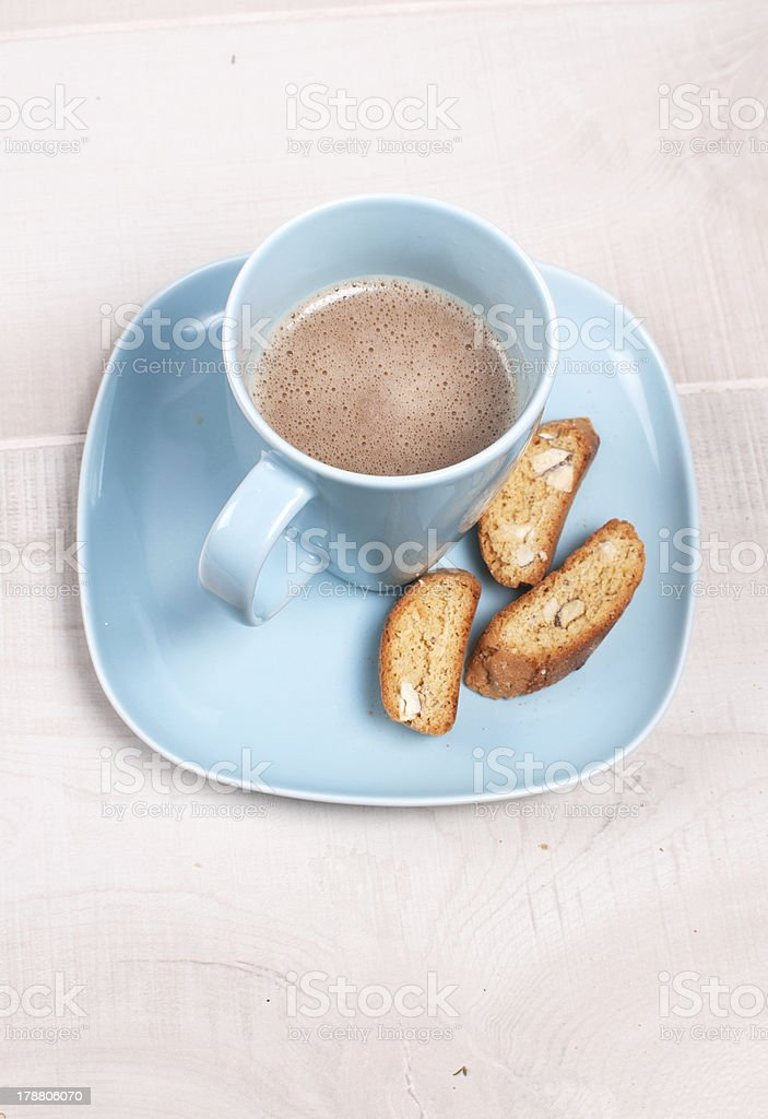 Blue cup of cocoa or chocolate with almond cookies royalty-free stock photo